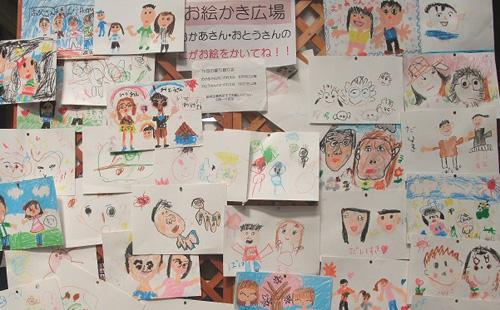 川崎銀柳街・銀座街商店街でお母さん・お父さんの似顔絵かきをしていただきました(2011年4月16〜17日)